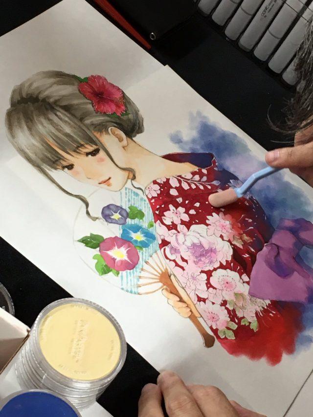 Un momento dello speed-painting di Haruhiko Mikimoto.